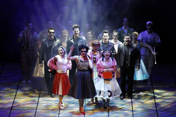 Lucy Maunder as Rizzo leads the cast of Grease. Photo: Jeff Busby
