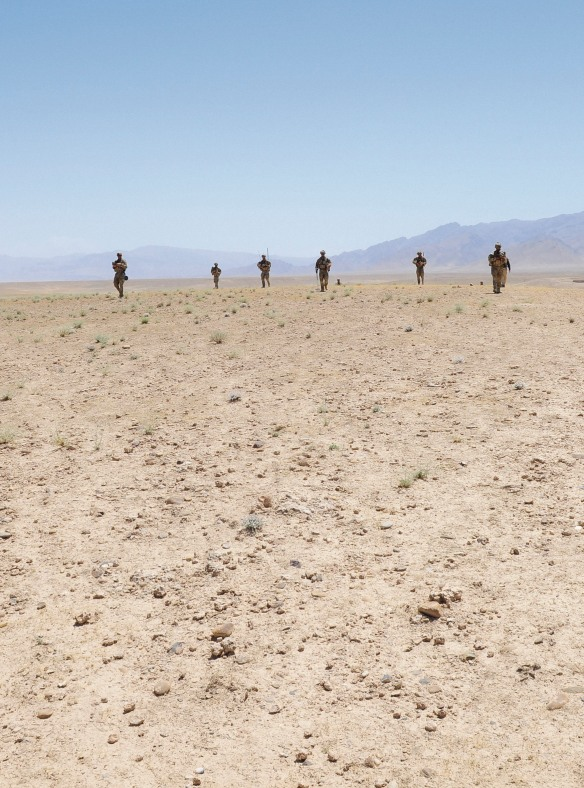 Members of Mentoring Team One, part of Mentoring Task Force - Four, move across the the 'Dasht' (desert) during a mentored patrol with members of the Afghanistan National Army in Uruzgan. Photo courtesy of the Australian Defence Force
