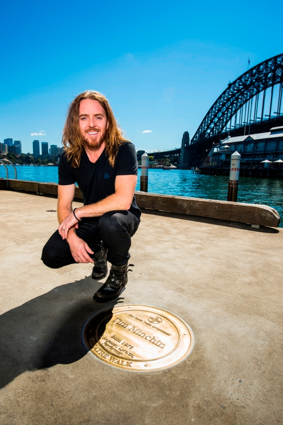 Tim Minchin is honoured with a plaque in Sydney's Theatre Walk. Photo: Brett Hemmings